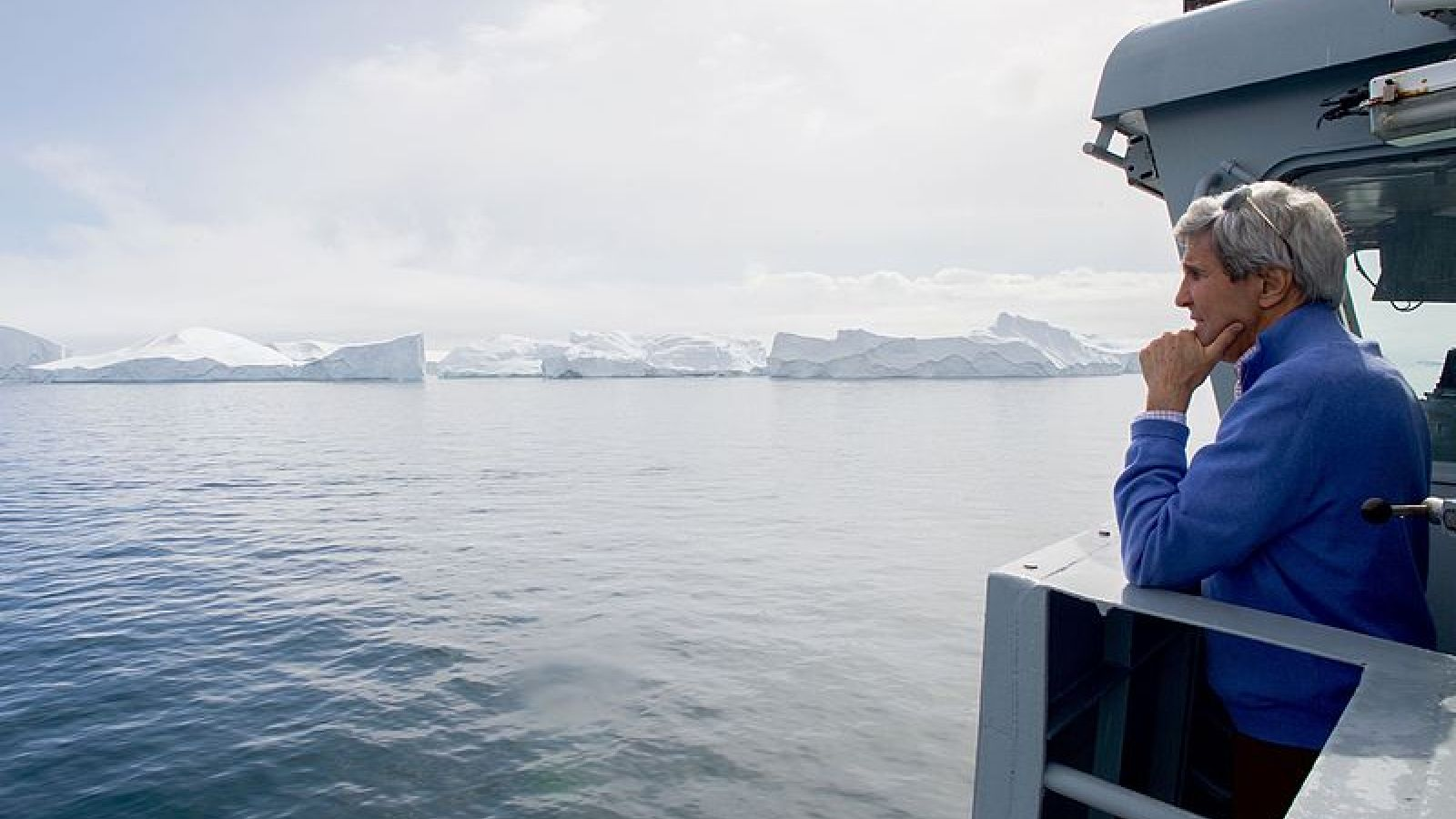 secretary_kerry_looks_at_icebergs_fro_the_bridge_of_the_hdms_thetis_after_it_pulled_out_of_the_port_of_ilulissat_greenland_27184414094
